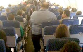 obese person on airplane