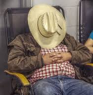 cowboy asleep in chair